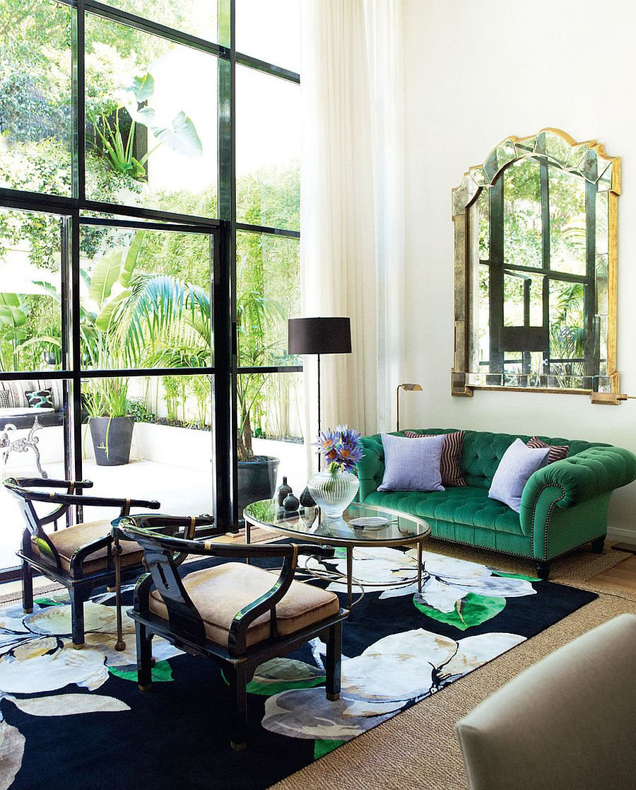 Dark sofa in green complements the color of the rug