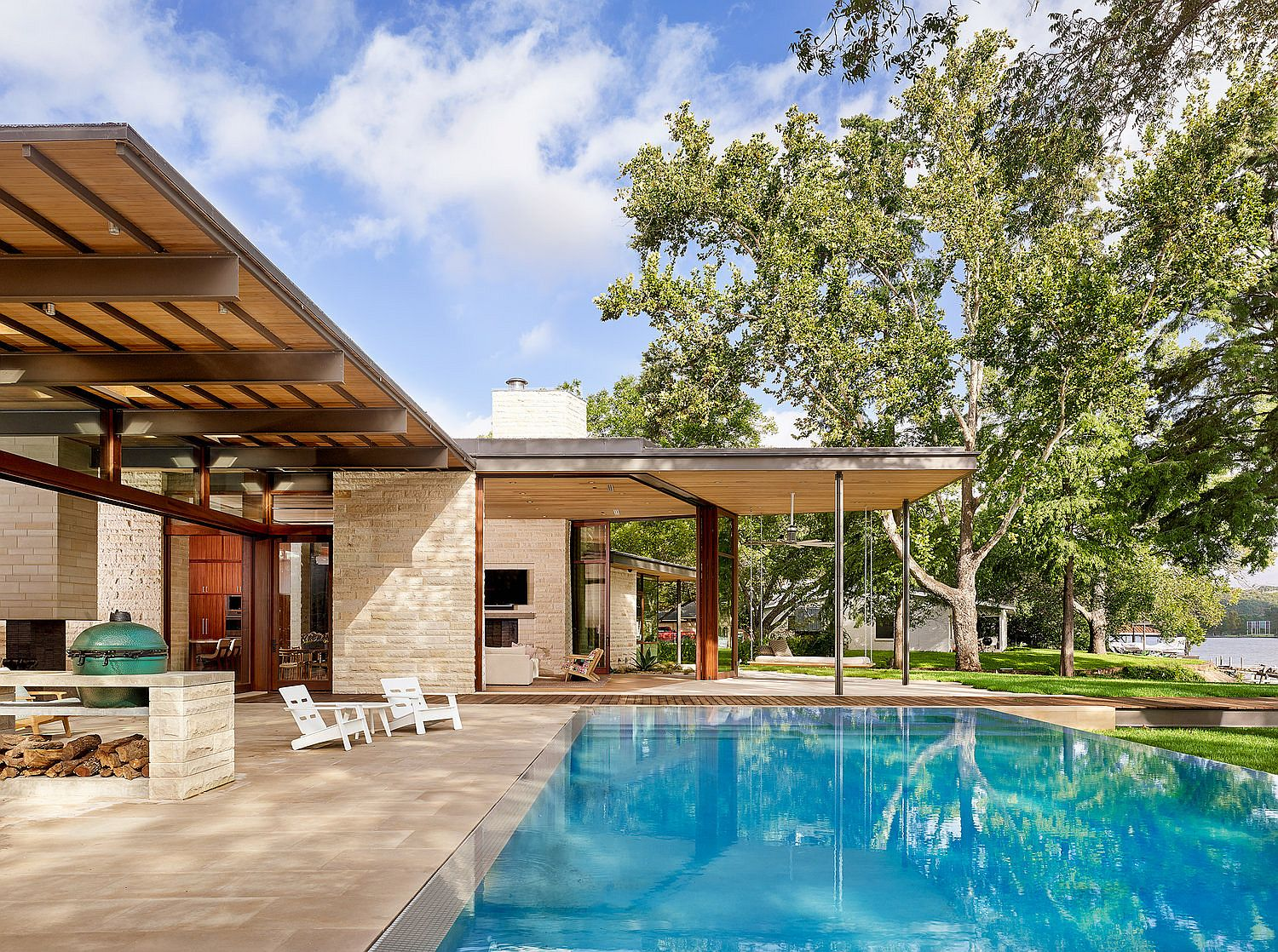 Deck and swimming pool area of the lavish lakeside Texas home
