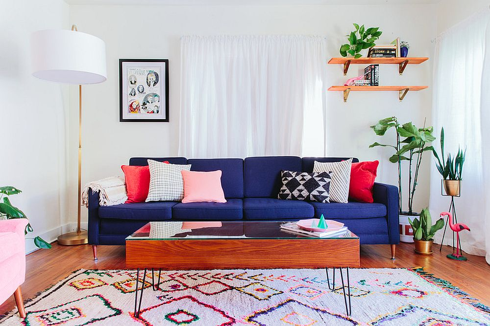Deep blue sofa in the living room steals the spotlight with ease