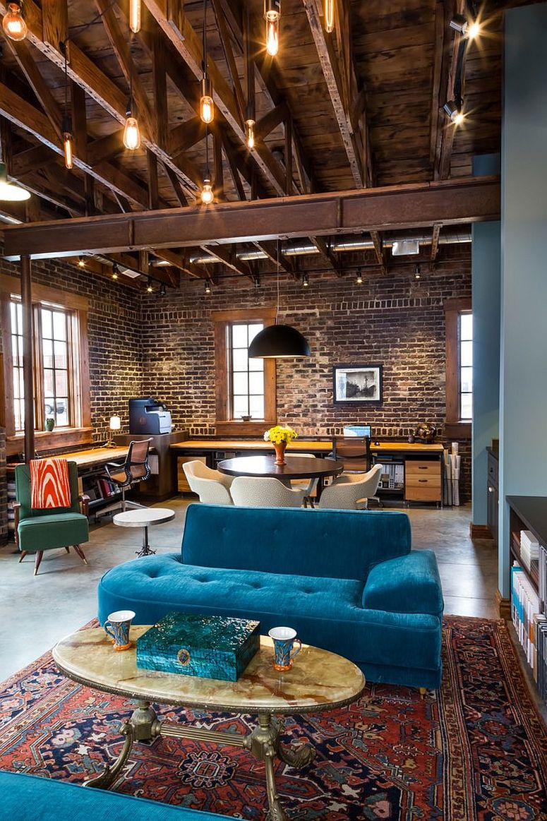 Double-height industrial living room with beautiful Edison bulb lighting
