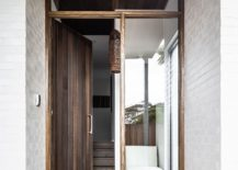 Entry-to-the-house-combines-wood-with-white-in-a-casual-manner-217x155