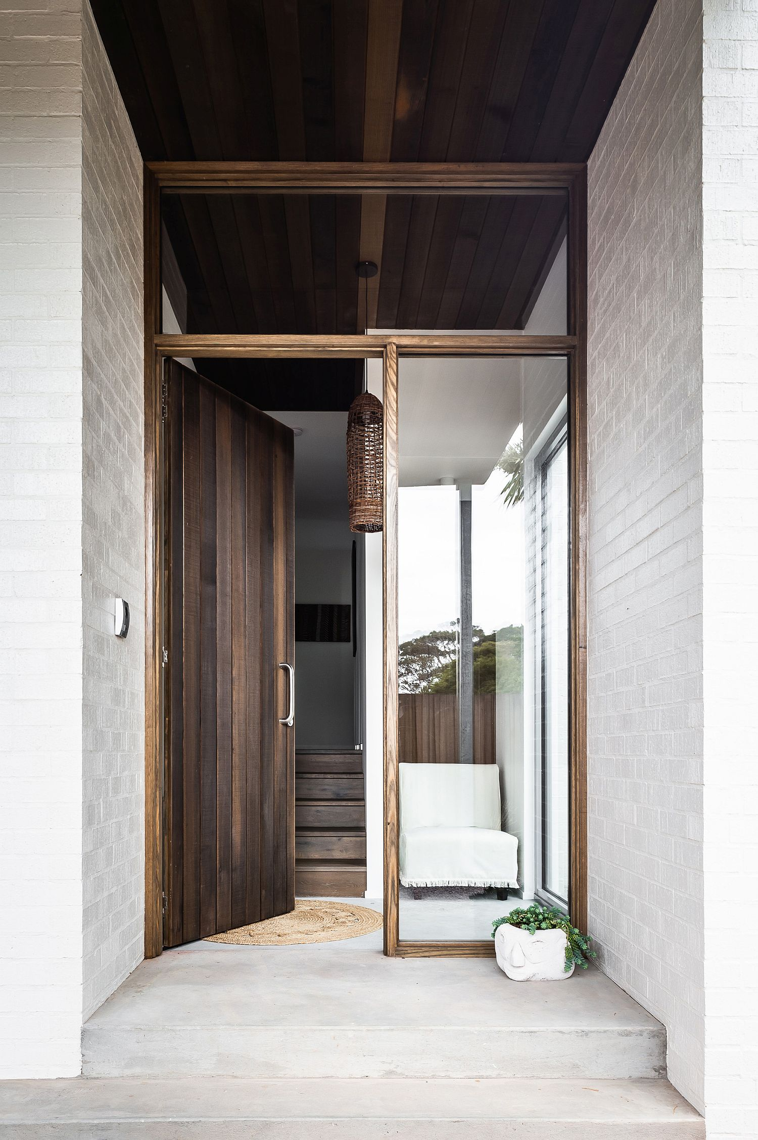 Entry-to-the-house-combines-wood-with-white-in-a-casual-manner