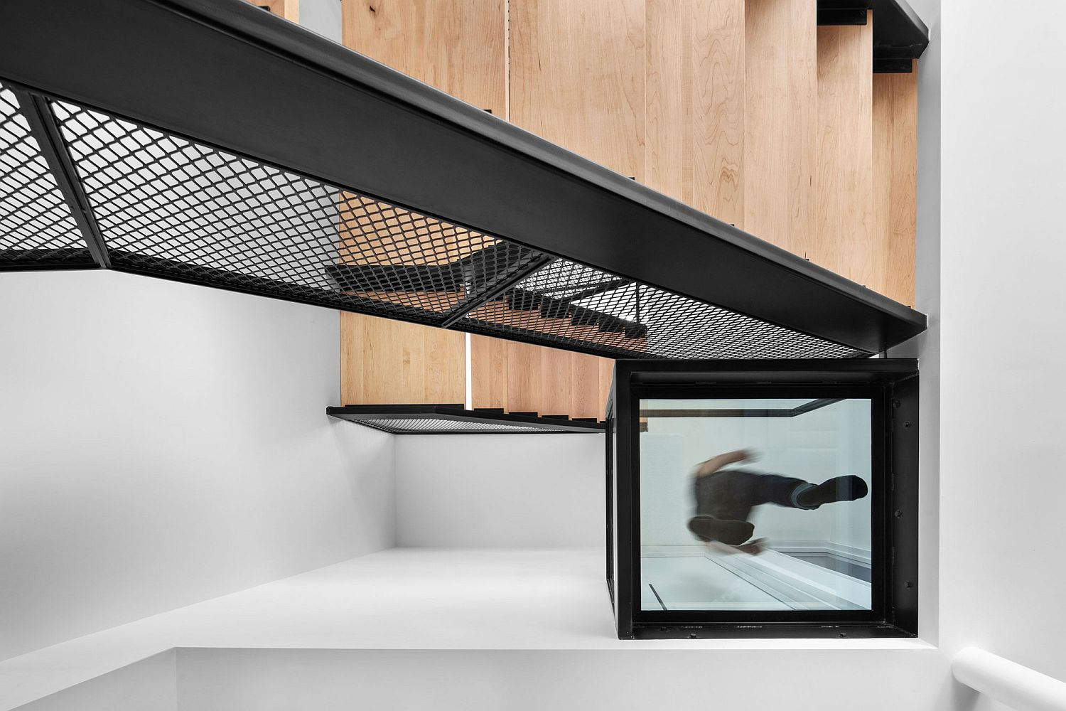 Fabulous modern stairway is the heart of the new multi-level home in Montreal
