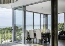 Glass-walls-and-sliding-glass-doors-bring-light-into-the-interior-217x155