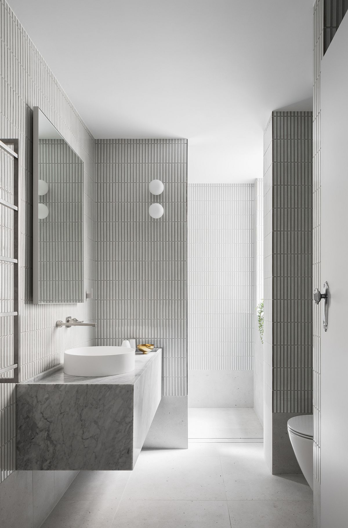 Gray and white bathroom with ample natural lighting