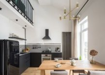 Large-opening-in-the-corner-brings-light-to-the-corner-kitchen-217x155
