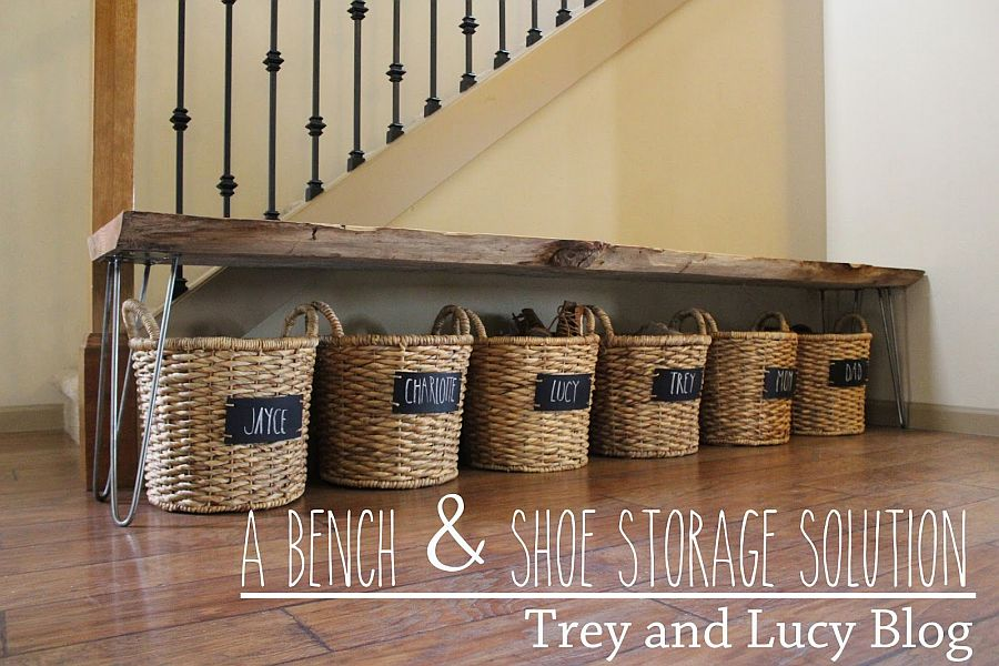 Live-edge table along with shoe storage baskets for the modern entryway