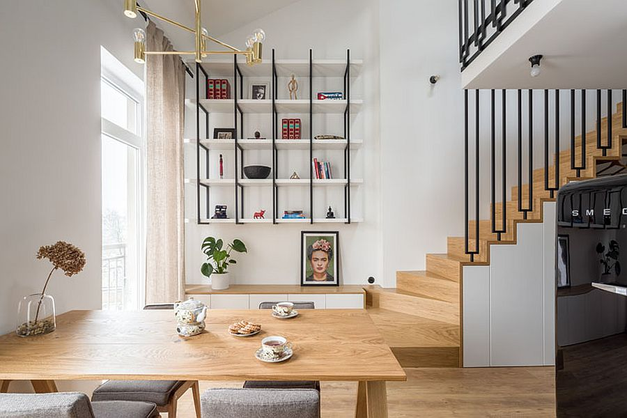 Lower level of the small apartment in wood and white with smart staircase