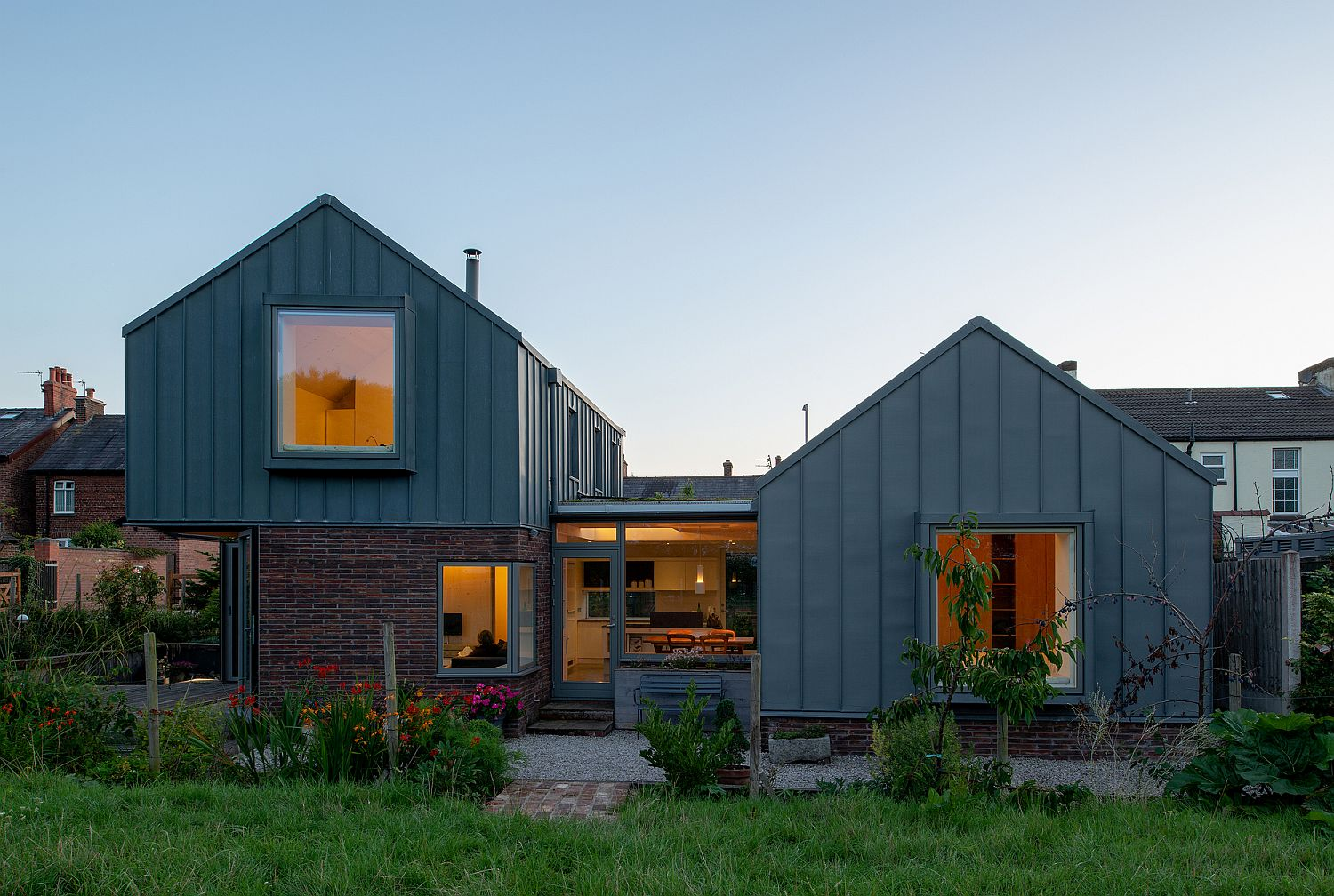 Masonary-brick-coupled-with-standing-seam-zinc-finishes-for-a-gorgeous-home