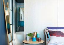 Master-bedroom-in-dark-bluish-gray-and-white-217x155