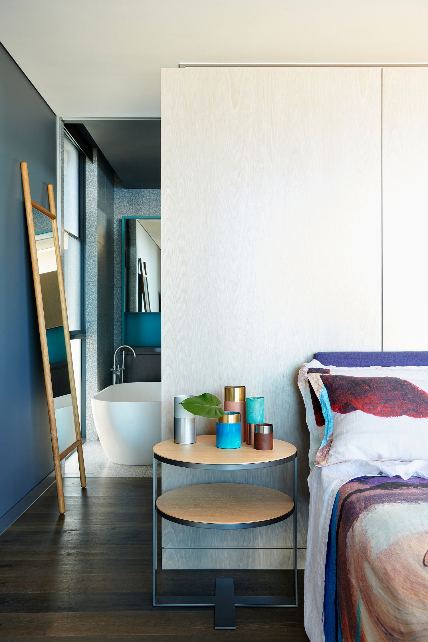 Master-bedroom-in-dark-bluish-gray-and-white