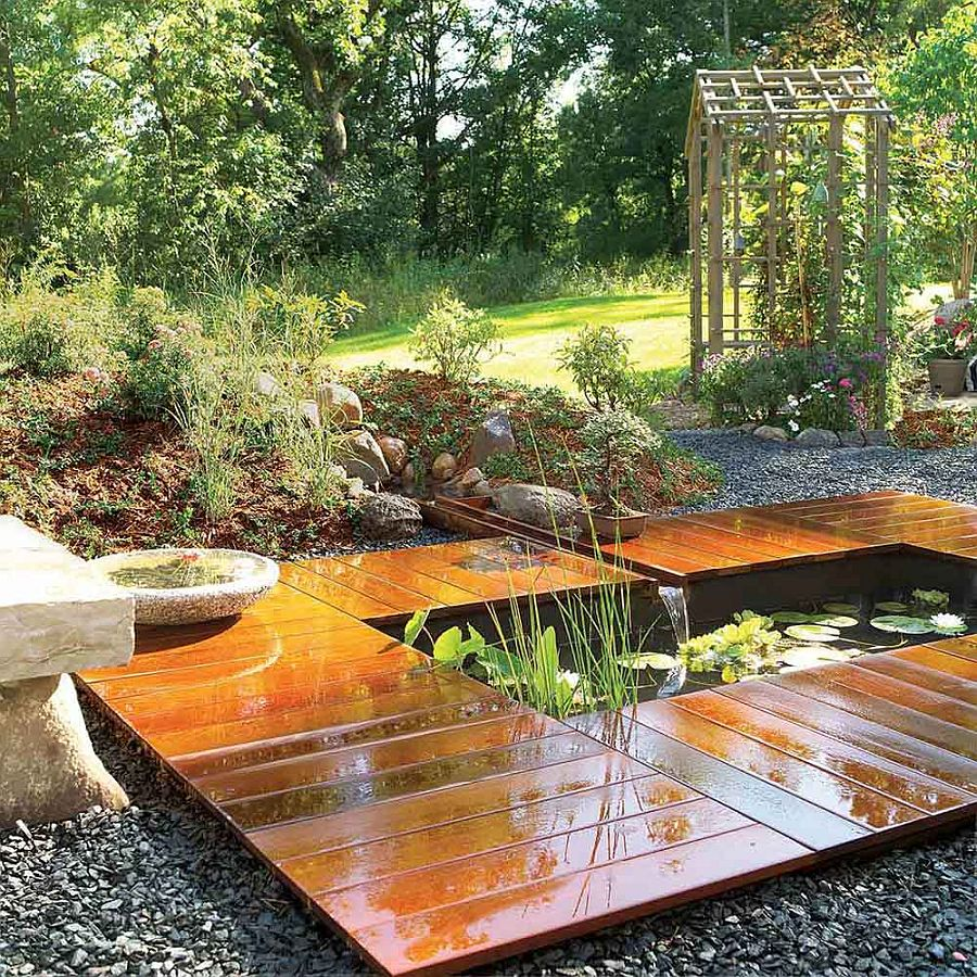 More fancier version of the simple and small backyard pond with wooden deck around it
