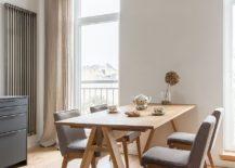 Multiple-windows-illuminate-the-lower-level-dining-area-and-kitchen-217x155
