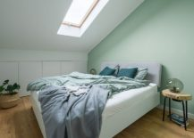 Pastel-green-accent-wall-for-the-mezzanine-level-bedroom-in-white-217x155