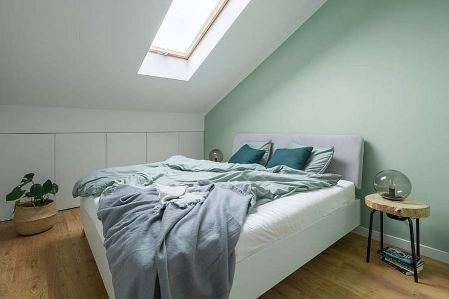 Pastel green accent wall for the mezzanine level bedroom in white