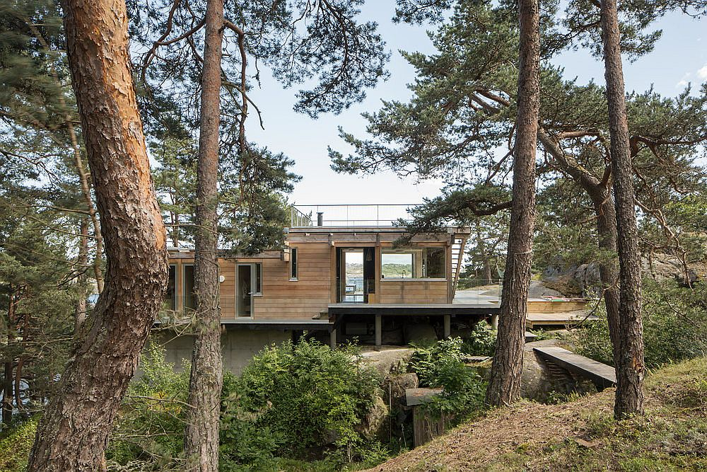 Pine trees around the cottage give it a sheltered presence