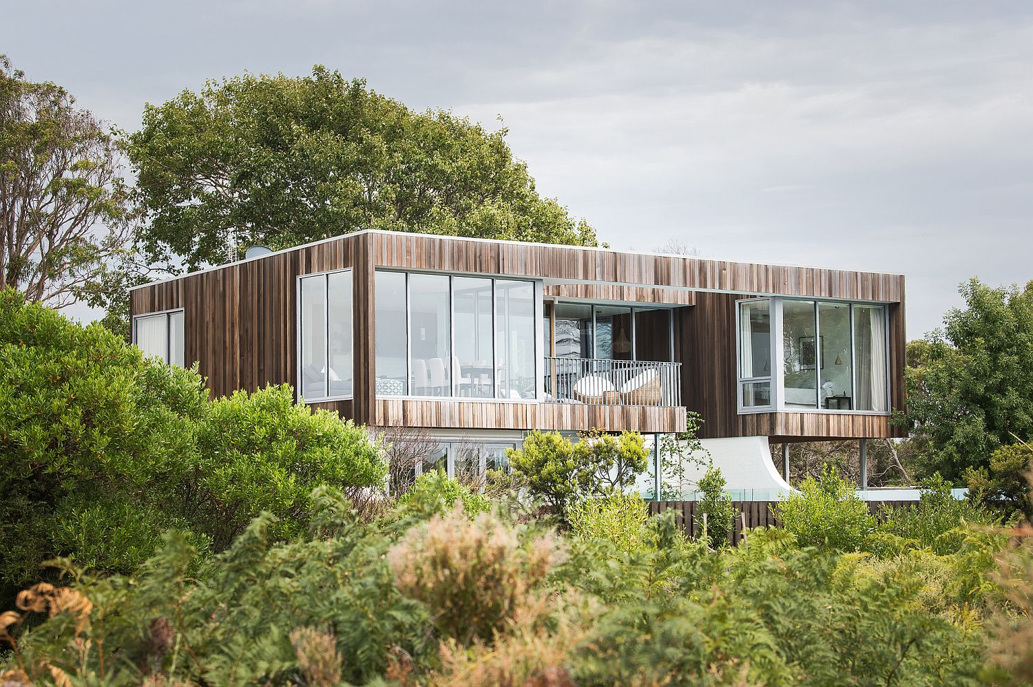 Rear-facade-of-the-Shearwater-Residence-draped-in-weathered-wood