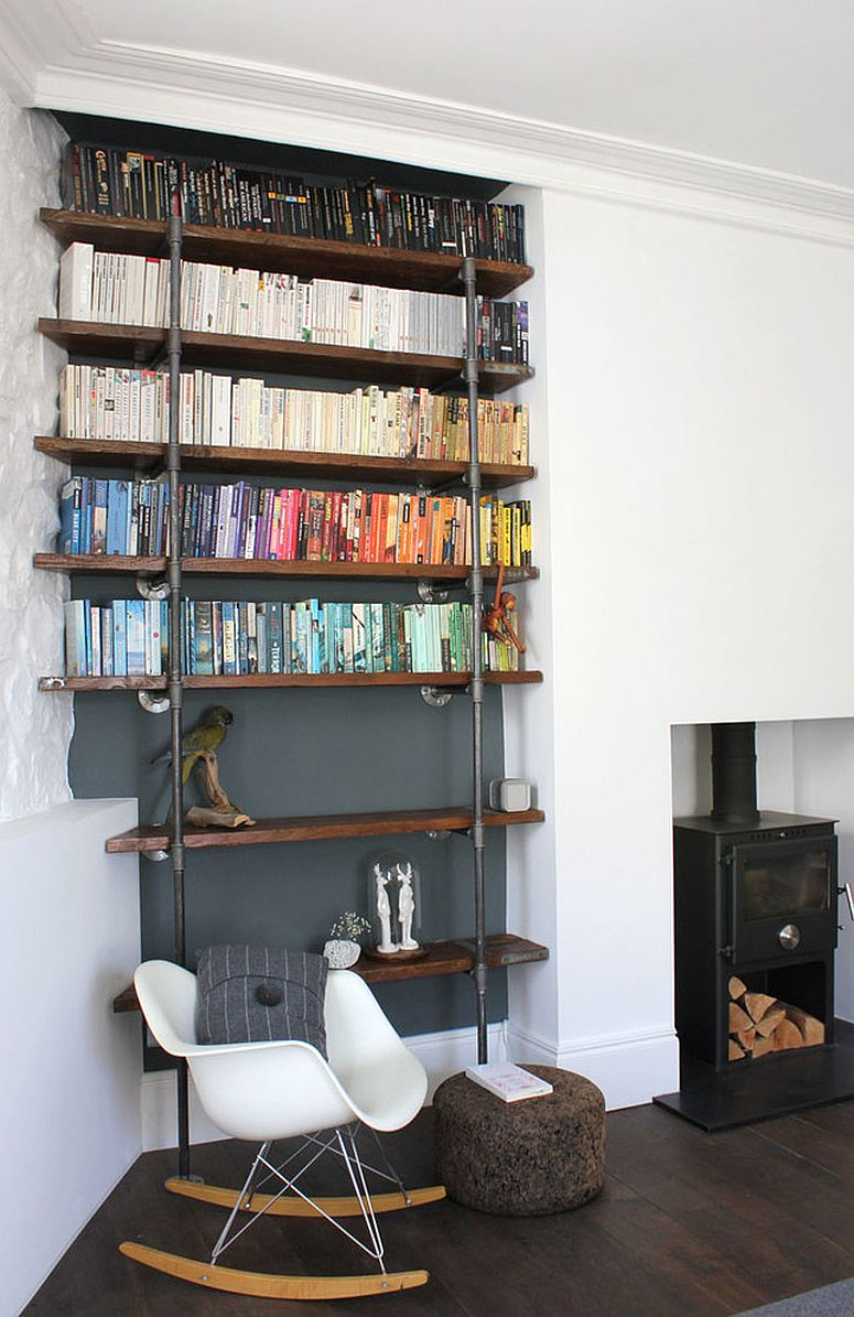 Reclaimed wood and metal pipes create a beautiful shelf in the living room
