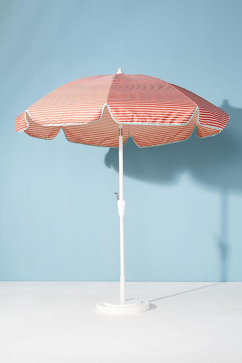 Red and white striped patio umbrella