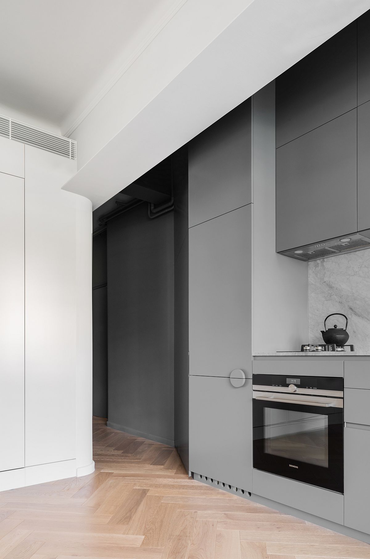 Single-wall kitchen in gray saves space while adding style to the interior