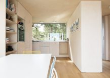 Small-and-stylish-kitchen-with-dining-area-next-to-it-embraces-Scandinavian-simplicity-217x155