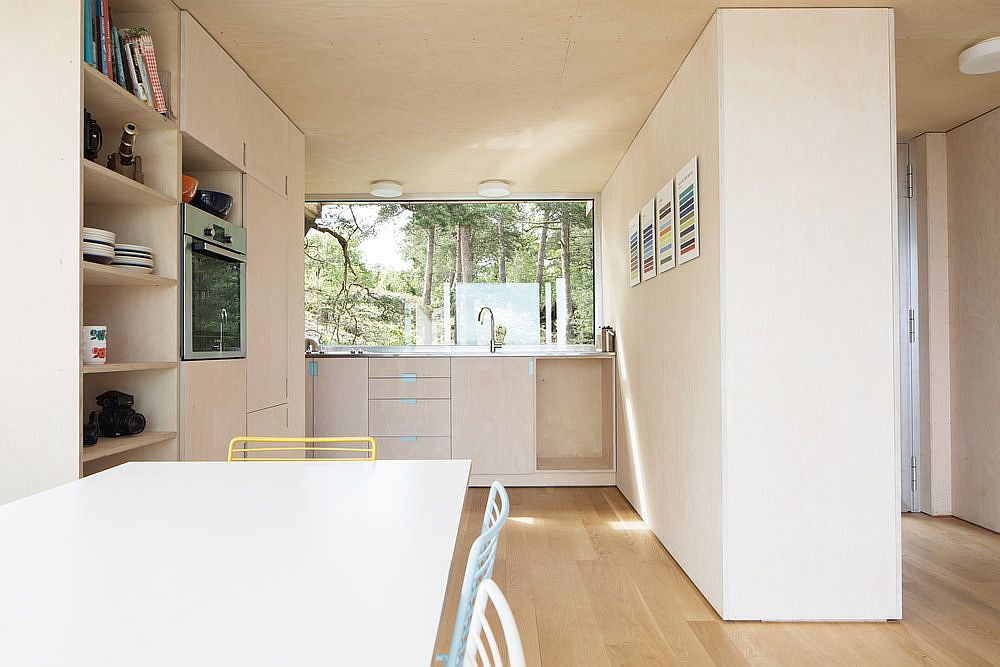 Small and stylish kitchen with dining area next to it embraces Scandinavian simplicity