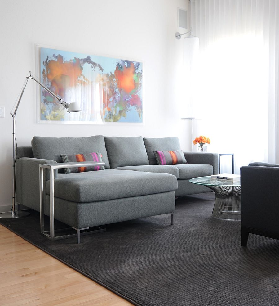 Small gray sectional stands out thanks to the white backdrop