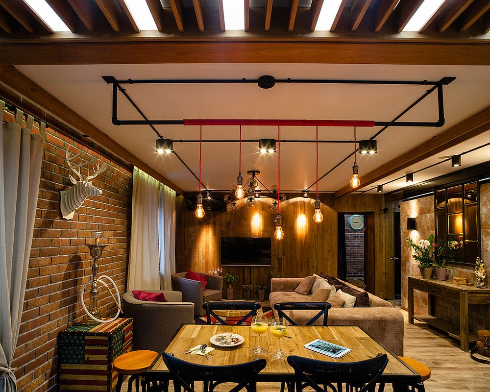 Small industrial living room with Edison bulbs and a touch of red