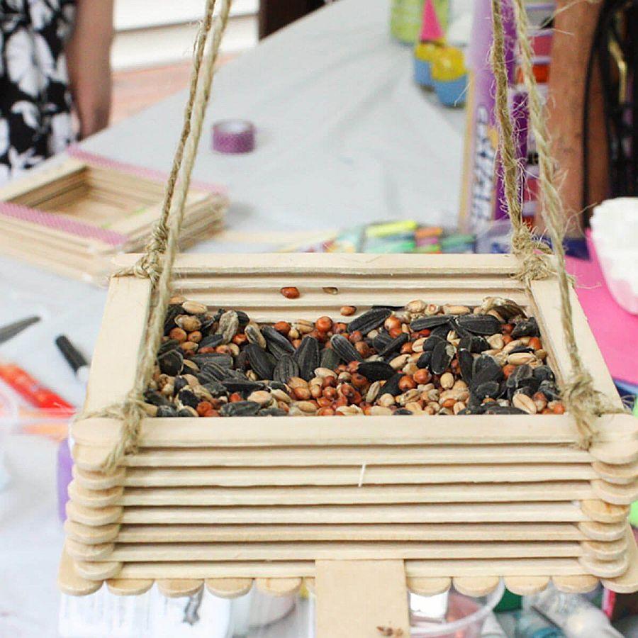 Smart-little-bird-feeder-made-using-craft-sticks-and-glue