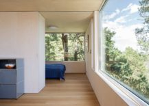 Spacious-and-light-filled-bedroom-of-the-cottage-with-brilliant-views-of-the-islets-217x155