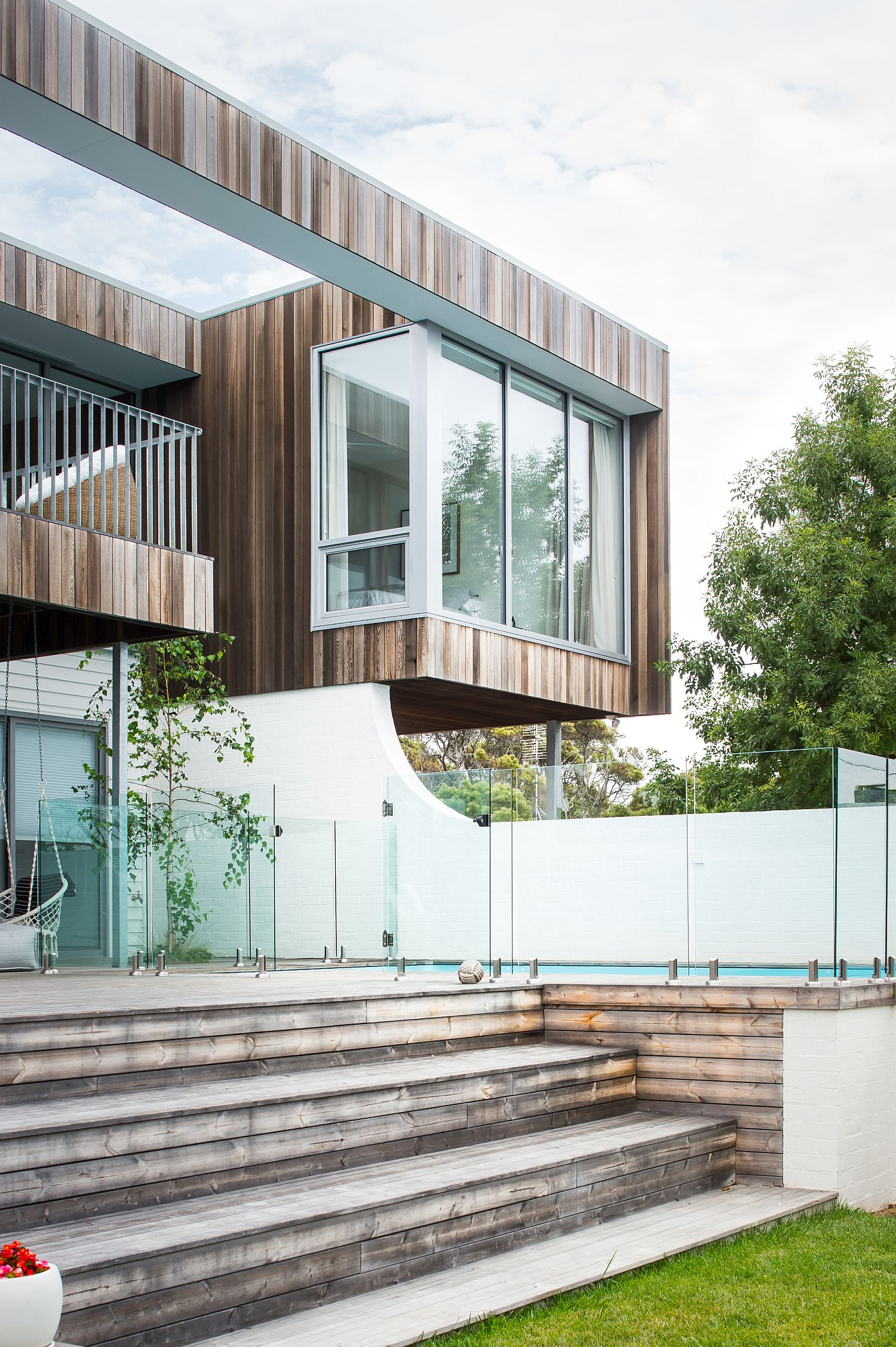 Spacious-wooden-deck-of-the-house-extends-the-living-area-into-the-garden