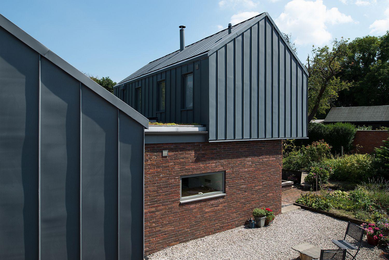 Standing-seam-zinc-frames-brick-and-glass-shape-beautiful-house-in-Lancashire