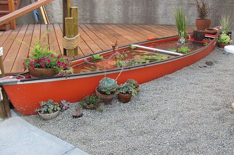 Stunning water canoe backyard pond DIY idea
