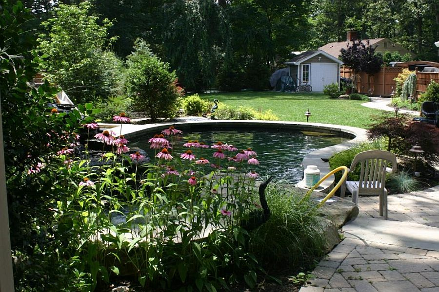 This 9-feet deep pond with concrete walls is a DIY creation that looks absolutely stunning