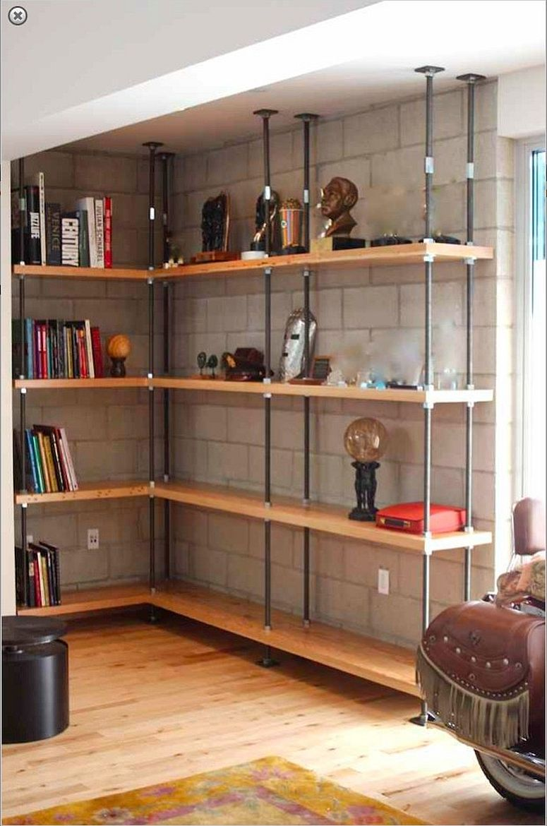 This wood and metal shelf in the living room saves corner space with ease