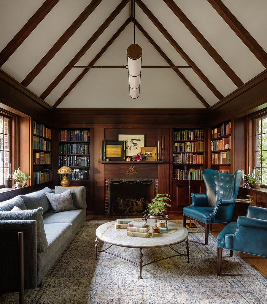 Wall of books in the backdrop adds color to the living room setting