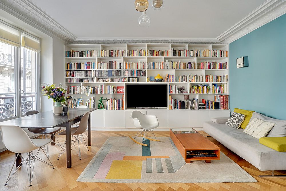White walls along with bookshelves make a bright background in the living room
