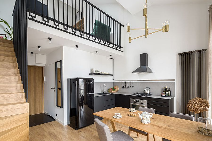 Wood-and-steel-staircase-leads-to-the-mezzanine-level-above