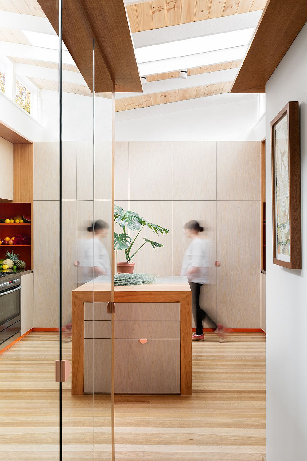Wood and white makes a bold statement in the light-filled kitchen