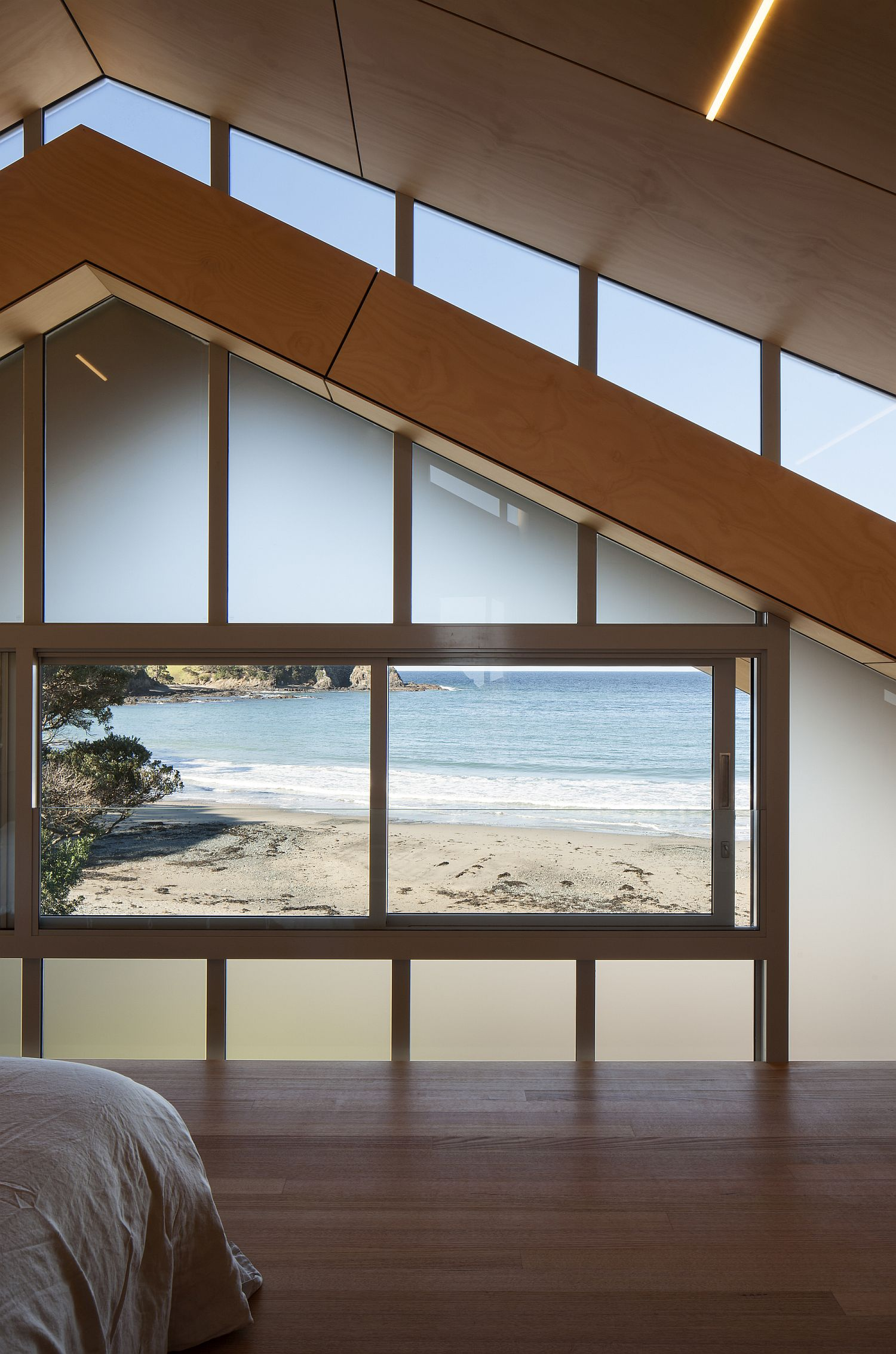 Amazing view of the beach from the comfort of the bedroom
