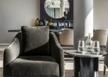 Artists-armchair-coupled-with-custom-granite-top-side-table-in-the-living-room-217x155