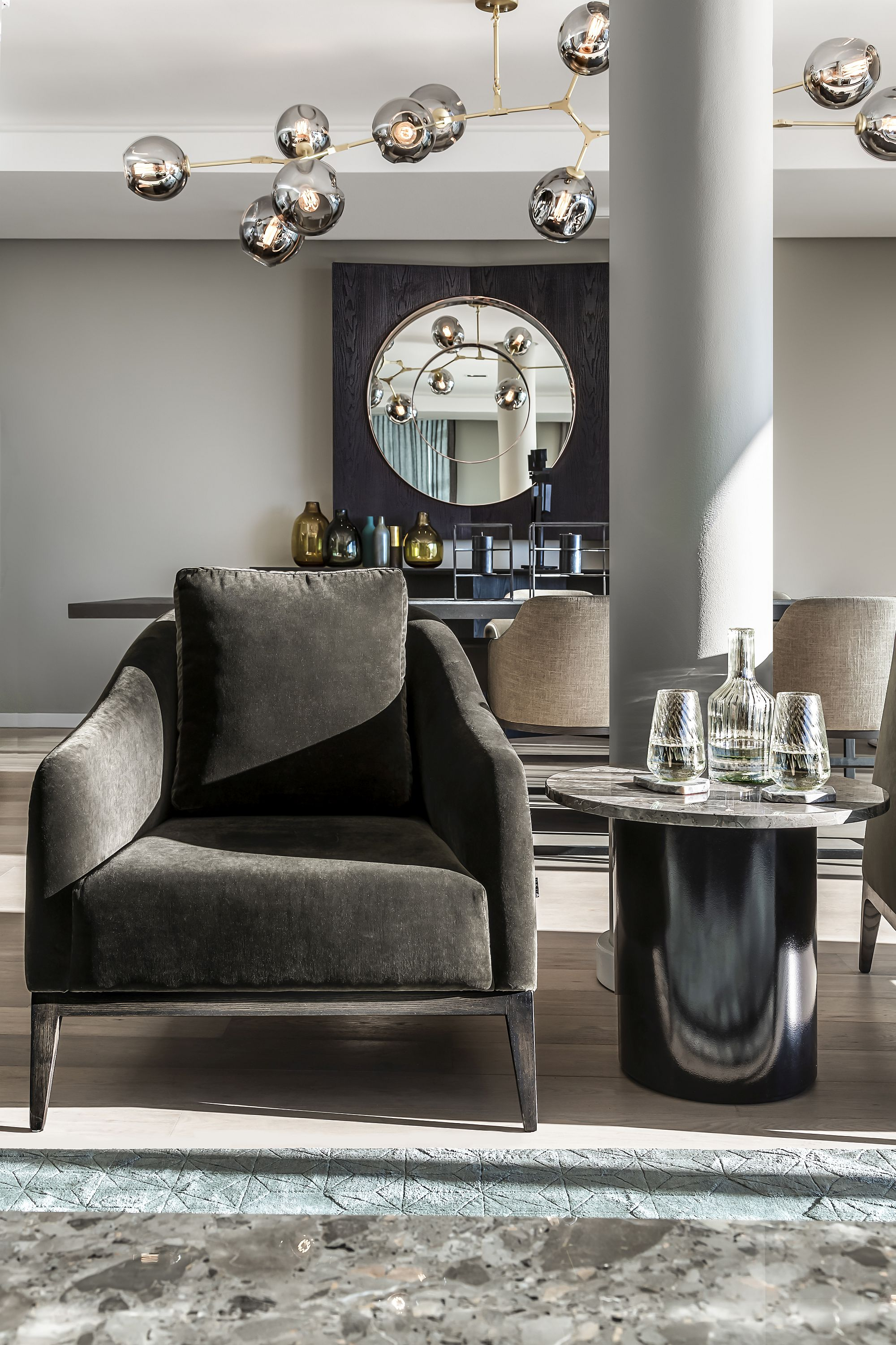 Artists-armchair-coupled-with-custom-granite-top-side-table-in-the-living-room