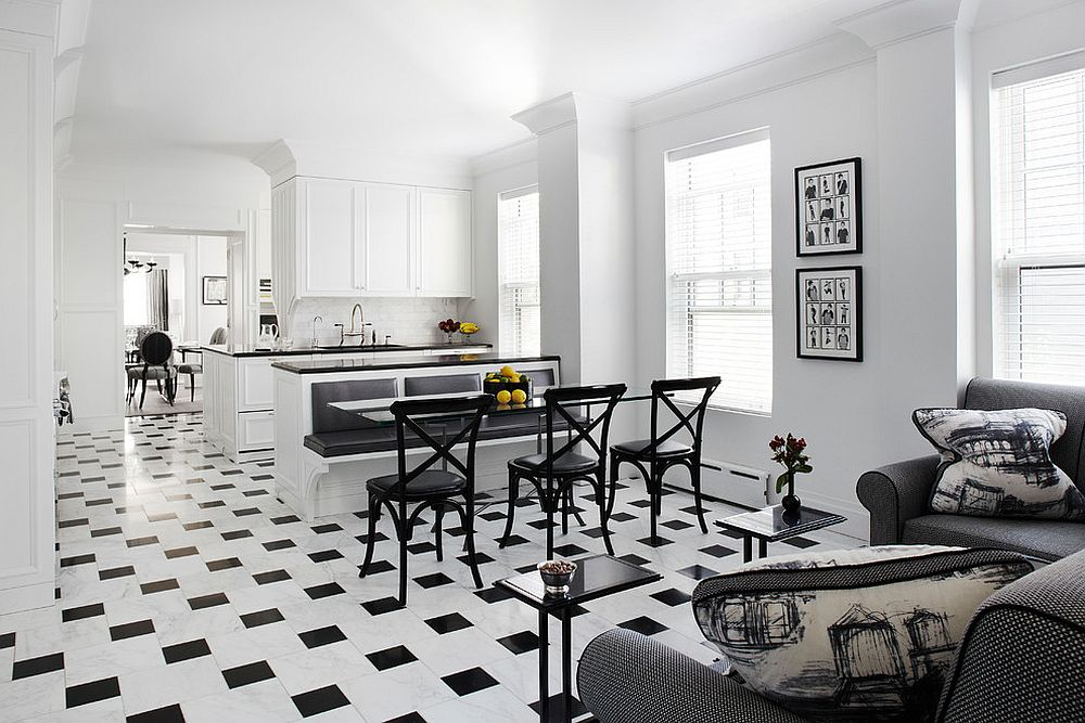 Awesome black and white kitchen extends the theme of living space next to it