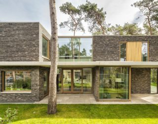 Warm Bricks, Timber Frames and Glass Brilliance Intertwined at This Dutch Villa
