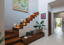 Beautifully-illuminated-wooden-staircase-with-storage-options-beneath-217x155