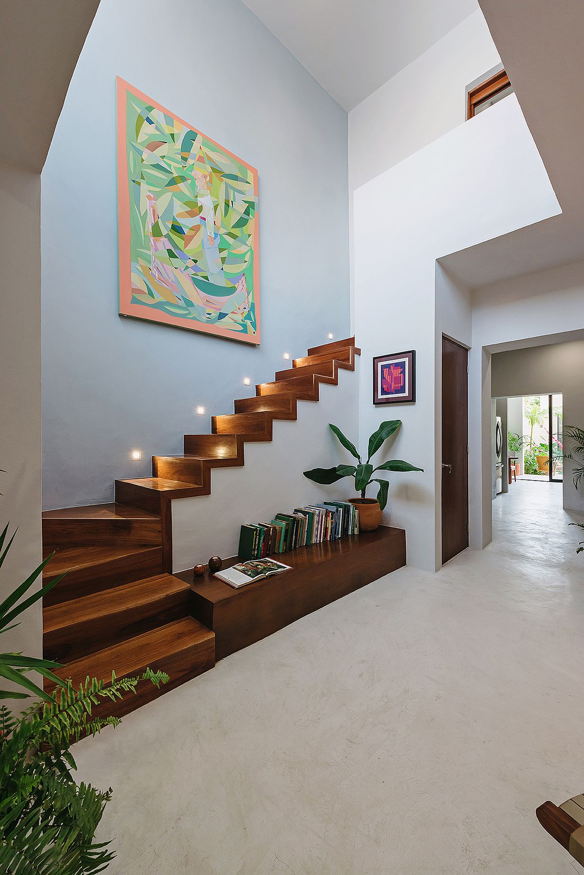 Beautifully-illuminated-wooden-staircase-with-storage-options-beneath