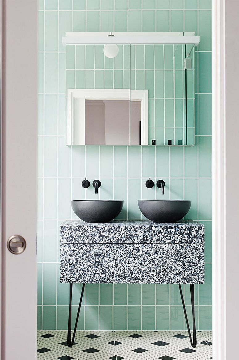 Black-sink-and-custom-vanity-for-the-bathroom-in-pastel-green-and-white