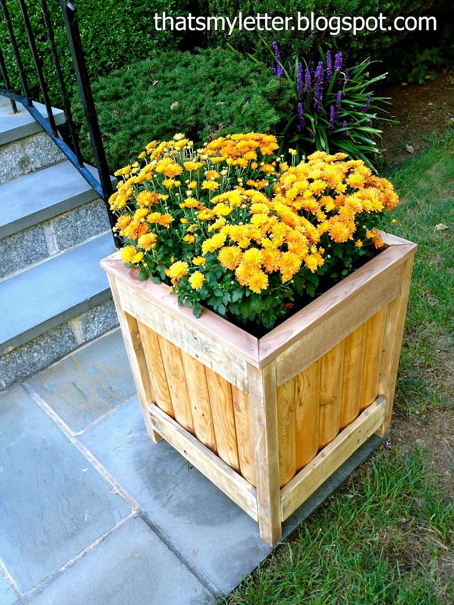 Box-style DIY planter with flowers can be placed on the yard