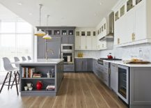 Brass-fxtures-add-metallic-glint-to-the-small-gray-and-white-kitchen-217x155
