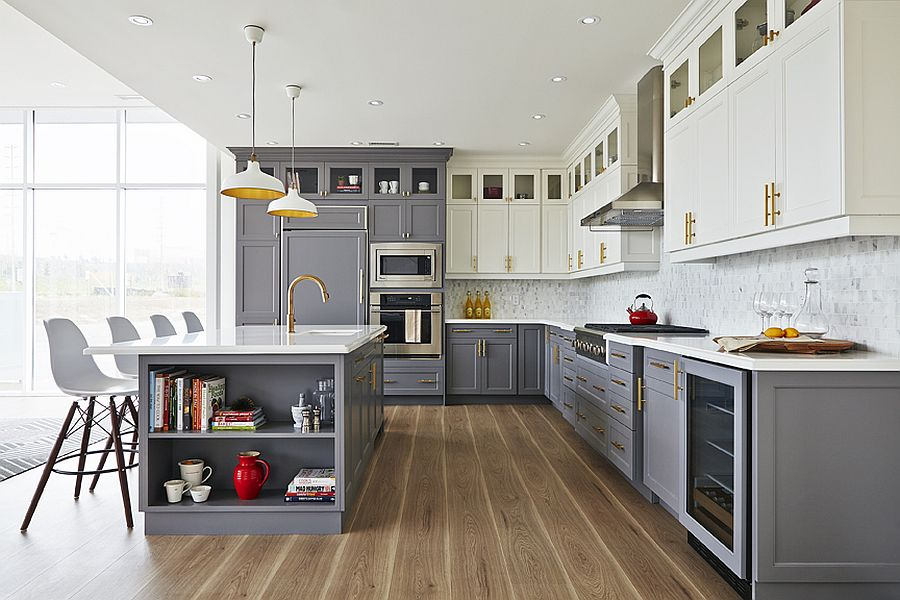 Brass fixtures add metallic glint to the small gray and white kitchen